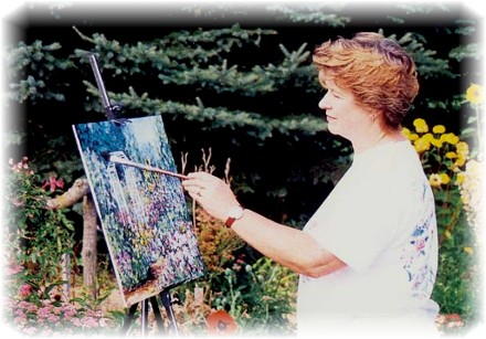 Elaine Tweedy painting in the arbor